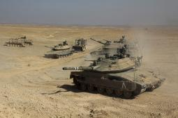 An Israel Defense Force Merkava Mark IV main battle tank and Caterpillar D-9 during an exercise in the Negev serest, Israel. Poster Print PSTZDN100151M