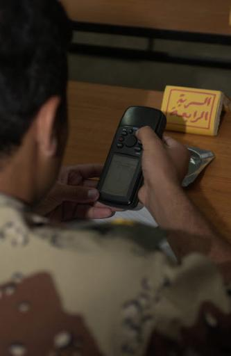 An Iraqi Army lieutenant learns how to use a handheld GPS device Poster Print by Stocktrek Images