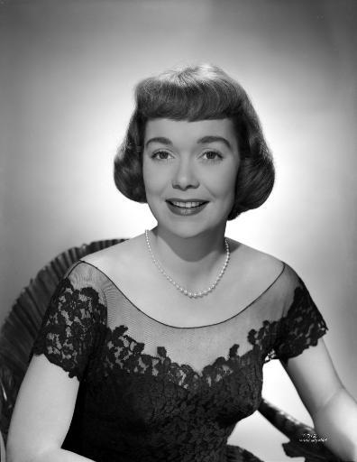 Jane Wyman Portrait in Black Linen Lace Shoulder Dress and Pearl Earrings with Pearl Necklace Photo Print