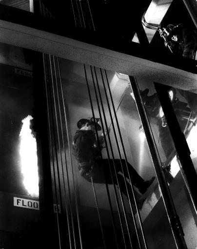 Film still featuring Paul Newman in The Towering Inferno Photo Print