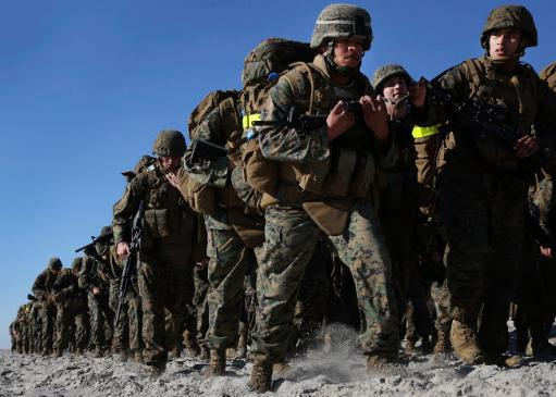Marines and sailors tramp through the sands of Onslow Beach Poster Print by Stocktrek Images PYSNQEXOHMQWKRGT