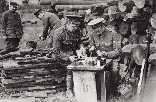 Tobacco Tins As Hand Grenades. Men Of The Royal Engineers Loading Reserve Stocks In Rear Of The Trenches During The First World War. From The.