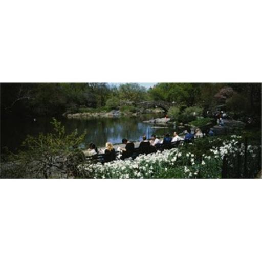 Panoramic Images PPI92672L Group of people sitting on benches near a pond Central Park Manhattan New York City New York State USA Poster Print by