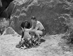 Johnny Weissmuller Filling the Sack with the Help of His Monkey in a Classic Movie Scene Photo Print GLP476871