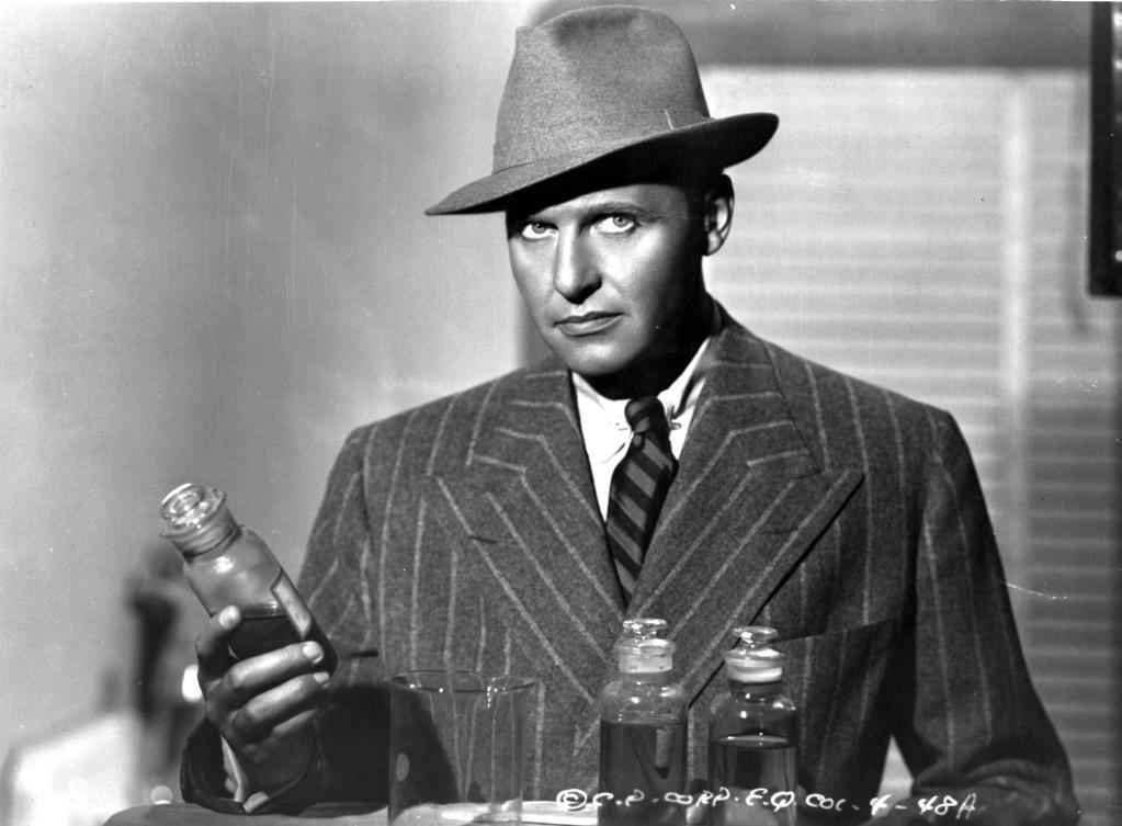 A publicity still of Ralph Bellamy holding a bottle Photo Print