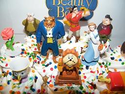 Beauty and The Beast Deluxe Mini Cake Toppers Cupcake Decorations Set of 14 with Figures a Sticker Sheet and ToyRing Featuring Belle The Prince Beast Chip and More