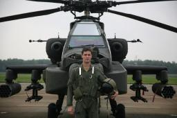 Pilot standing in front of an Apache helicopter Poster Print by VWPics/Stocktrek Images