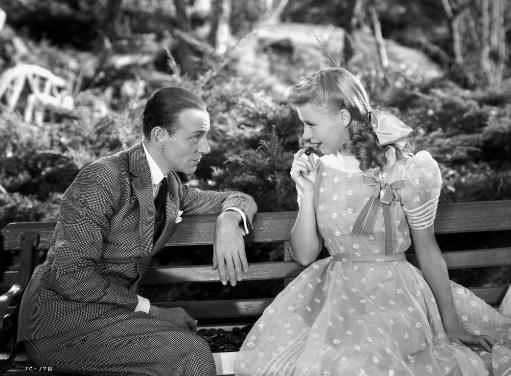 Fred Astaire and Ginger Rogers sitting on Bench Photo Print