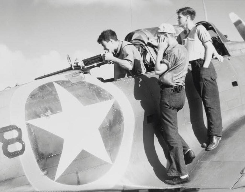 A radioman gunner fires a machine gun on the SBD-3 Dauntless scout bomber, 1942 Poster Print by Stocktrek Images