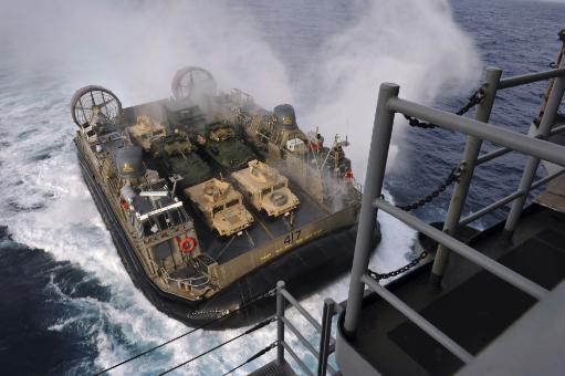 East China Sea, February 2, 2013? Landing Craft Air Cushion approaches the well deck of the forward-deployed amphibious assault ship USS.
