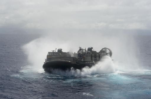 July 13, 2014 - A U.S. Navy landing craft air cushion departs from the amphibious dock landing ship USS Rushmore 2014. Poster Print