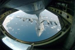 A C-130 Hercules is refueled by a KC-135 Stratotanker Poster Print by Stocktrek Images