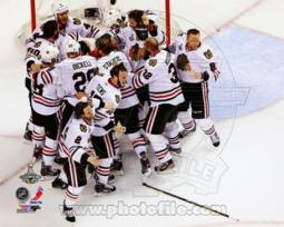 The Chicago Blackhawks celebrate winning Game 6 of the 2013 Stanley Cup Finals Sports Photo PFSAAQA04801