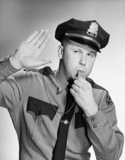 Police officer blowing a whistle and making a stop gesture Poster Print