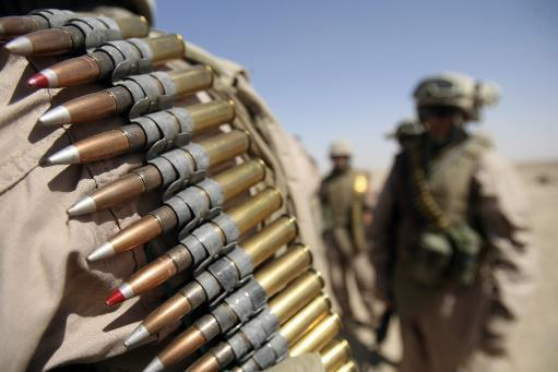 June 13, 2006 - Belts of .50-caliber ammunition hang from the shoulders of Marines at live-fire range near Camp Fallujah, Iraq. Poster Print