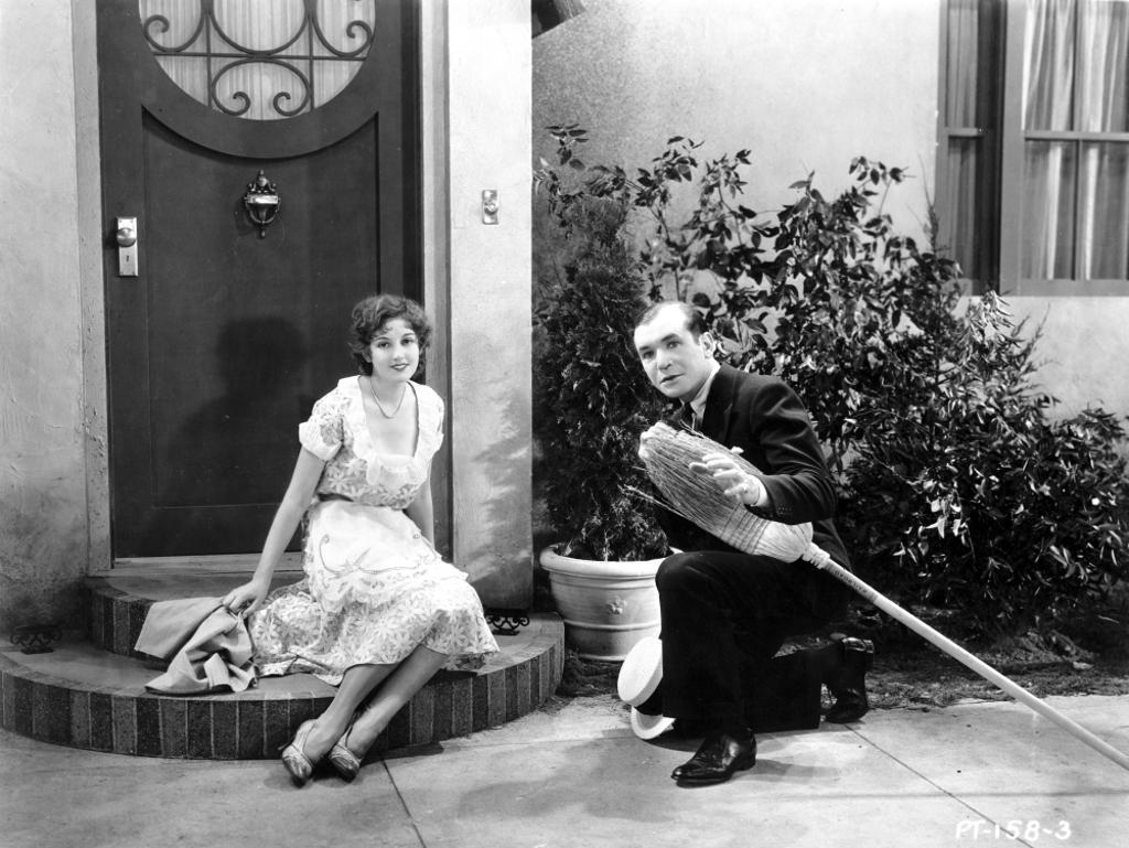 A promotional still of Harry Richman carrying a broom Photo Print