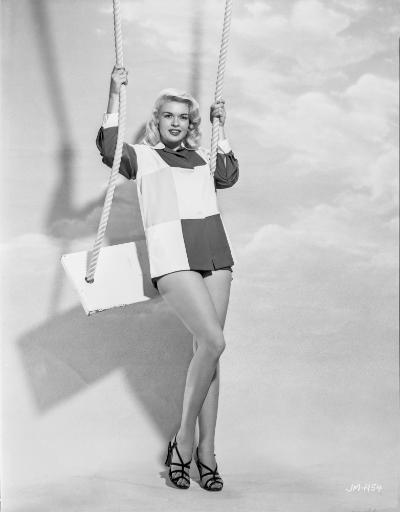 Jayne Mansfield Posed and Stood on the Swing in Two Tone Long Sleeve Shirt and Black High Heel Sandals Photo Print